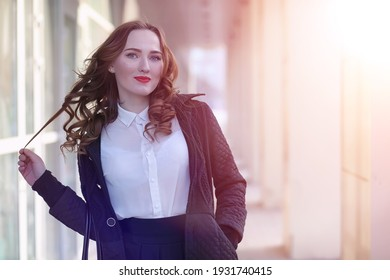 Girl business woman in the spring on a walk in a coat outdoor