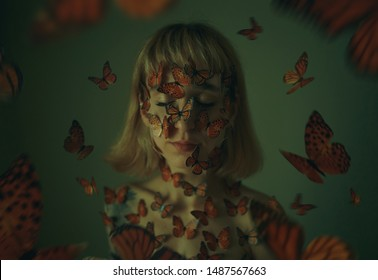 girl with butterflies. many butterflies are sitting on a girl. Close up portrait of the beautiful young woman and butterflies on her face. conceptual photography / arthouse
