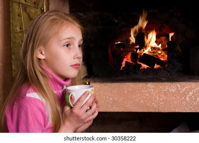 girl by the fireplace drinking milk