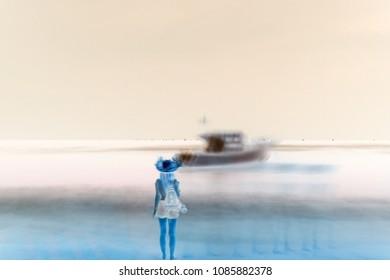 A girl by the ocean at night, long exposure. Defocus