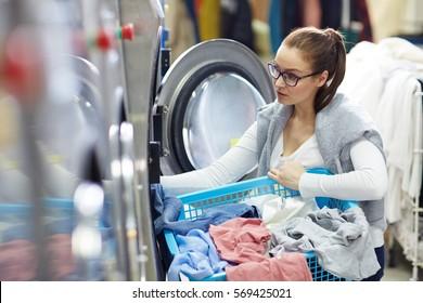 Girl by washing-machine
