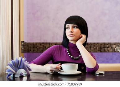 girl in cafe with coffee cup