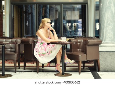 Girl at the cafe table