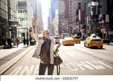 Girl calling taxi cab in New York City