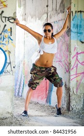 girl in camouflage posing in unfinished building