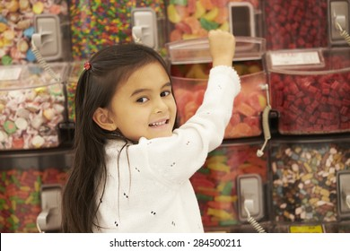 Girl At Candy Counter In Supermarket