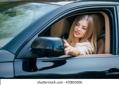Girl in car arrange mirrow of back view