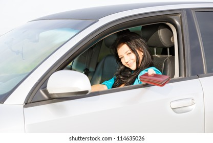 girl in the car gives a driver's license