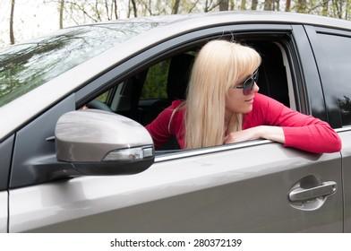 Girl in the car looks back