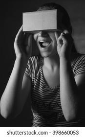 girl in a cardboard VR glasses
