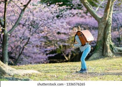 Girl carrying a school bag