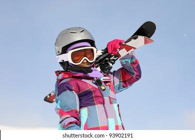 Girl carrying skis