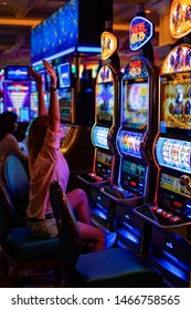 girl in a casino in Las Vegas,  the woman plays for the slot machine, July2019