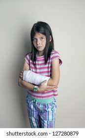 girl with a cast on  broken wrist or arm