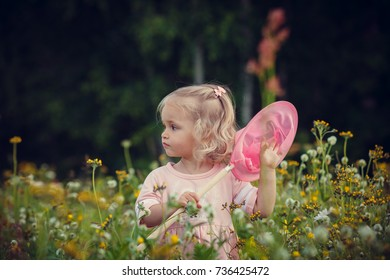 girl catches butterflies