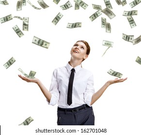 Girl catches the falling money / stock image of money falling around happy businesswoman - isolated on white background