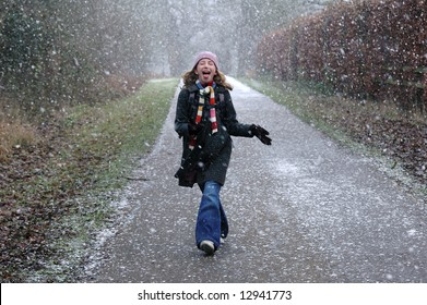 girl catching snowflakes on tongue