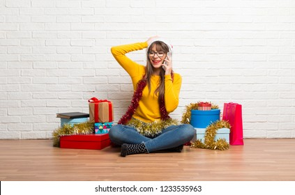 Girl celebrating the christmas holidays keeping a conversation with the mobile phone with someone