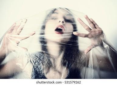 Girl in cellophane film.
