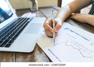 The girl is checking the company's finances. As a result, the company gained profits from the sale of properties, thus expanding its business to East Asia.