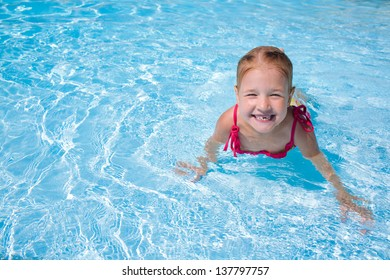 girl child in blue water