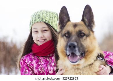 girl child and dog Shepherd