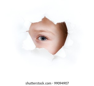 girl child eye in torn paper hole isolated