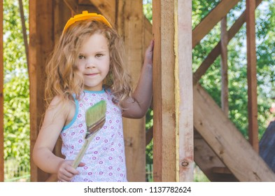 girl, child handles frame house fire protection, wooden construction, biosecurity