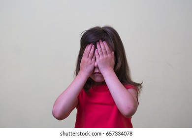 Girl child hands closed his eyes