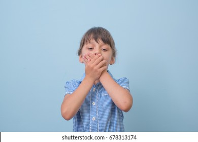 Girl child Hands closed mouth
