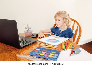 Girl child learning art lesson online on laptop Internet. Virtual drawing painting class on video during self isolation at home. Distant remote video education. Modern homeschool study new normal.