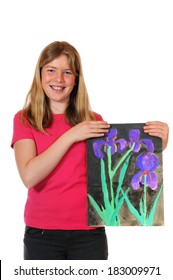 Girl with childrens paintings