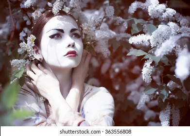 Girl with chinese style makeup in flowers