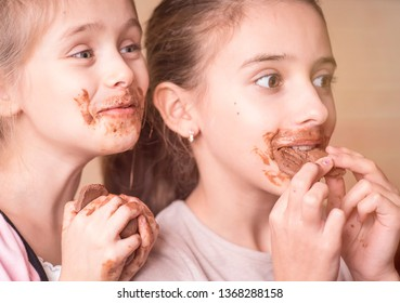 Girl with chocolate.Girls, children eat chocolate, a mouth and hands of girls are smeared with chocolate.