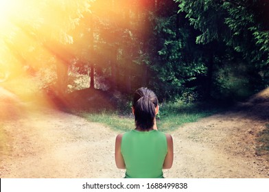 Girl with a choice near the forked road.The concept of the solution: the path to success and the path of risk