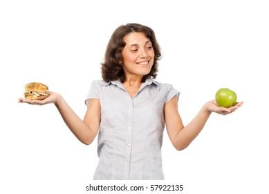 Girl chooses between a green apple and hamburger