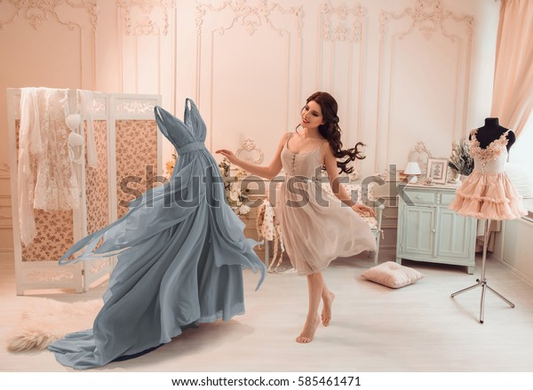 Girl chooses a dress to wear on a date. Positive atmosphere. Live wear circling around the room. Creative colors