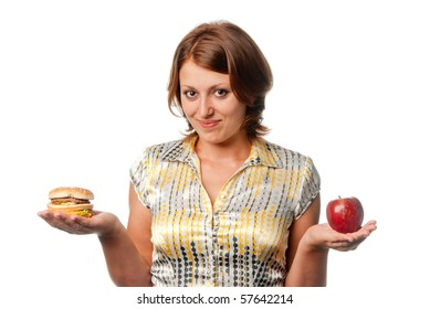 Girl is chosen between apple and hamburger