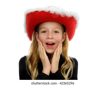 Girl with christmas hat looks surprised over white background