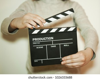 girl with clapper board