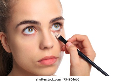 A girl is cleaned with bruises under her eyes on a white isolated background
