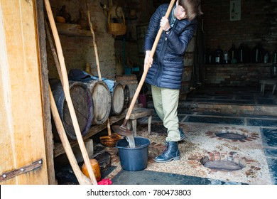 Girl is cleaning of the georgian wine kvevri
