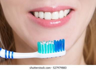 girl cleans teeth by brush