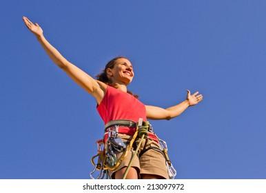 girl climber on a mountain top