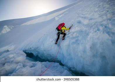 Girl climbing the mountain in the morning
