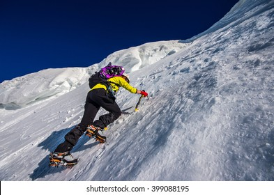 Girl climbing the mountain on snow field