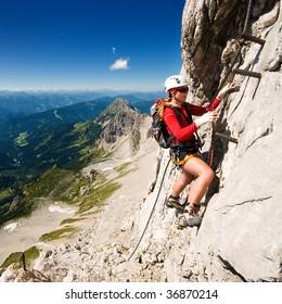 girl climbing mountains