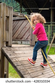 girl climbing on playground