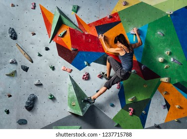 girl is climbing in the training room