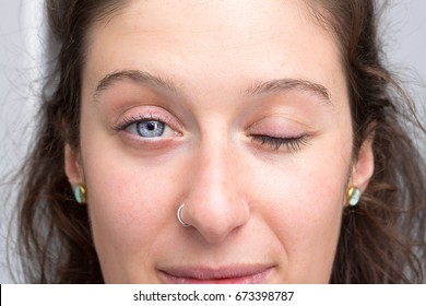 Girl with a closed eye and an open one